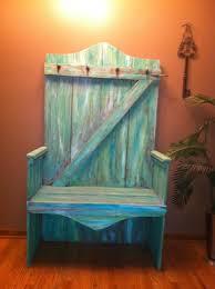 barn door made into a coat rack bench
