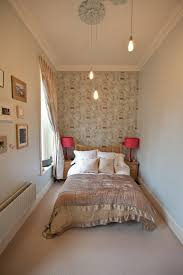 edison bulbs and ceiling medallion with wallpaper plus wood headboard and nightstand with drum lamp shades gorgeous teenager bedrooms
