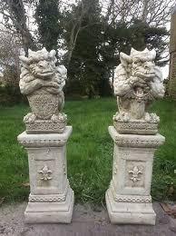 stone garden pair sword shield gargoyles ornaments finials statues on plinths