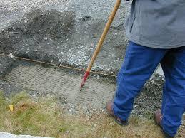 shovel concrete into footing