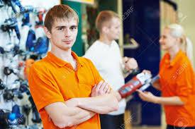 shop assistant seller in supermarket store stock photo picture stock photo shop assistant seller in supermarket store