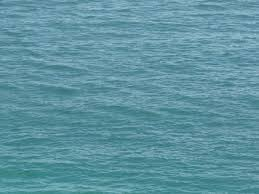 calm water texture. Ocean Water Texture In Vibrant Blue Tone With Small Waves On Surface. Calm A