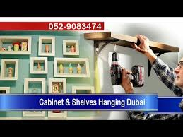 shelves hanging by professional handyman advance laser level dust free