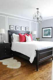 small master bedroom ideas wooden bed and headboard fuscha pop pillows side tables chandelier small white