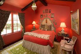 magnificent cheetah print bedding in bedroom mediterranean with red ceiling next to bedskirt alongside red bedding and picture lighting