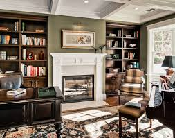 comfortable home office. builtit shelving and a gas log fireplace add elegance to an office comfortable home