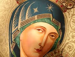 her dark blue mantle represents the color that identifies her as a palestine mother which also means that she is both virgin and mother