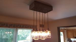 how to create a mason jar chandelier using reclaimed barn board