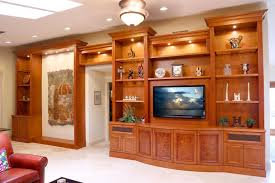 elegant pura vida miami for a traditional family room with custom in wall units