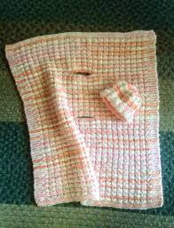 i used deborah norville serenity baby which is a heavy worsted weight acrylic and very soft and easy to knit the large onholes are for the car seat