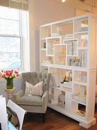 freestanding bookcase living room divider to use between desk area and workout area