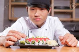 Sushi Cook Professional Presentation Of Meal Young Japanese Cook In Blurry