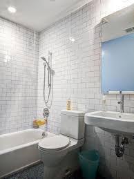 floor to ceiling subway tile bathroom. white subway tile plays well against the dark charcoal mosaic floor in this contemporary bathroom. extending from to ceiling gives bathroom s