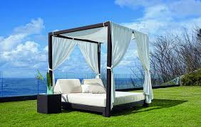 ... Hanging outdoor bed with wooden sunshade and light curtain
