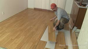 how to remove glued wood laminate flooring