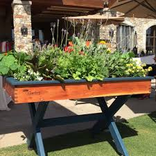 the patented tablegarden is offered in three sizes the standard tablegarden has a soil capacity of 2 5 cubic feet a planting depth of 5 inches
