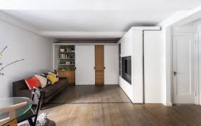 One Room Living Space Watch A Sliding Storage Wall Morph This Micro Apartment Into 5 Rooms