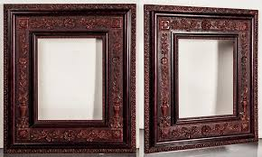an 1890 1910 very unusual highly detailed thermoplastic resin similar to gutta percha raised design reddish frame with reddish wood trim