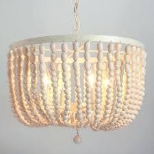 whitewashed chandelier world market antique whitewash wood bead chandelier whitewashed candle chandelier