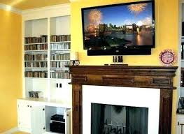 mounting tv over fireplace living room how to