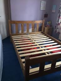 Wooden double bed frame. Slatted head and foot boards. Slatted base ...