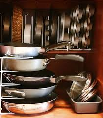 kitchen cabinet organizers storing pans in trays cake pans baking sheets and