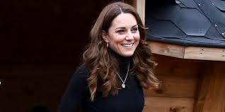 Kate Middleton wears leopard-print skirt and camel coat