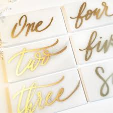 table numbers. set of calligraphy marble tiled table numbers