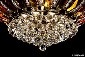 contemporary gold chandelier isolated on black background crystal chandelier decorated amber crystals close up