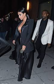 chic kanye kept it just as formal dressed in a white tuxedo jacket with a