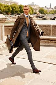 look the best you possibly can in a brown trench and a grey plaid wool suit