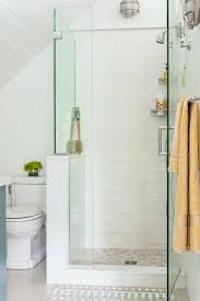 a subway tiled shower enclosed with frameless glass makes for a functional and unfussy bath bathroom shower toilet