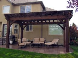 12 x 20 timber frame pergola kit installed over backyard patio for shade