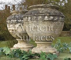 antique stone planters and pedestals by