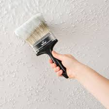 first apply ez strip popcorn ceiling remover this can be done with a wide paint brush or roller