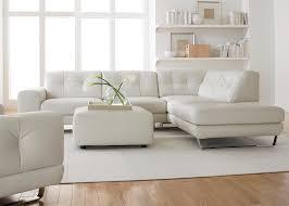 minimalist floating desk setup in white for designer with storage