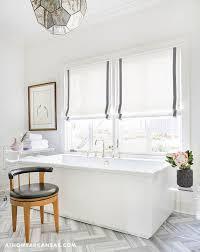 modern rectangular bathtub with mercury glass chandelier