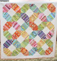 Stitching Sprinkles: Charm Pack Tutorials & Amy Smart of Diary of a Quilter posted a beautiful picture of her Rainbow  Connection quilt. Its a really different look, combining charms and HSTs. Adamdwight.com