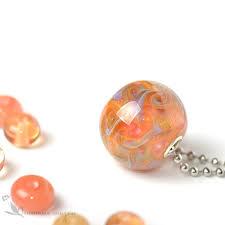 pendant globe glass lampwork peach warm apricot mono pendant is a modern stylish accessory peach lampwork