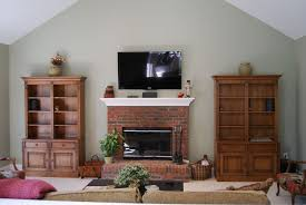 tv over brick fireplace with front left right bookshelf speakers center channel speaker