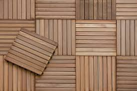 wood flooring is an instant fix lay slatted wood tiles in a grid on a flat surface to transform a balcony deck or concrete pad into an inviting outdoor
