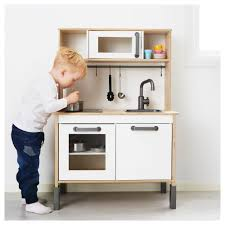 ... Toddler Kitchens Play Kitchen Wood A Kid Pretend To Cook With Pan On  The ...