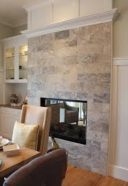 this portland street of dreams fireplace is tiled in pewter turkish travertine