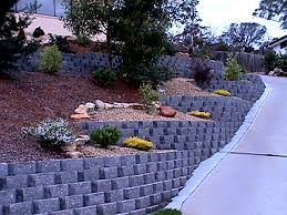 the norfolk retaining wall block system is a stepped 17 interlocking wall system with a rock face textured finish and a natural palette of colours to