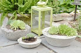 Save lots of money by making your own chic and modern concrete planters  with this easy