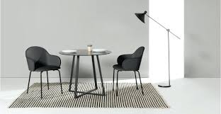 a dining table in black and smoked glass round decor