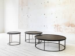 this distinctively designed series of round tables lends a stylish and playful note to any interior the combination of materials a solid oak top with a
