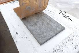 Concrete cast with a wood grain mold. Might make some interesting stepping  stones.