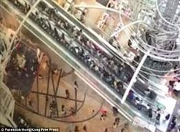 people on escalator. at least 17 people were injured when an escalator in a shopping centre hong kong on n