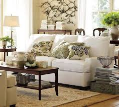subtle s curve in the base pottery barn living room luxury red rug rectangle light brown leather tufteed ottoman coffee table round top metal side microfib
